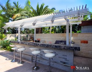 Enjoy a bbq next to your pool under an Adjustable Patio Cover from Solara.