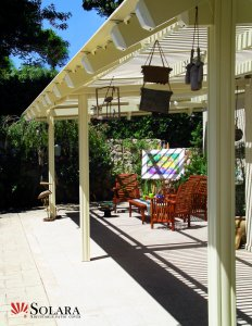Enjoy a sunny day under a Solara Adjustable Patio Cover