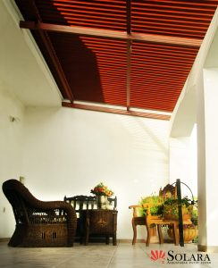 Sit and relax under a Solara Adjustable louvered roof system.
